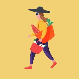 Vrouw na het winkelen groente