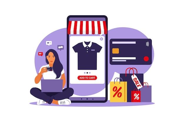 Vrouw online winkelen. betaal met credit card. uitverkoop. illustratie. vlakke stijl.