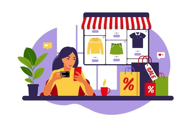 Vrouw online winkelen. zwarte vrijdag. betaal met credit card. uitverkoop. modern concept voor web. vlakke stijl.