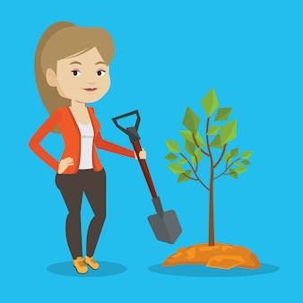 Vrouw plant boom.