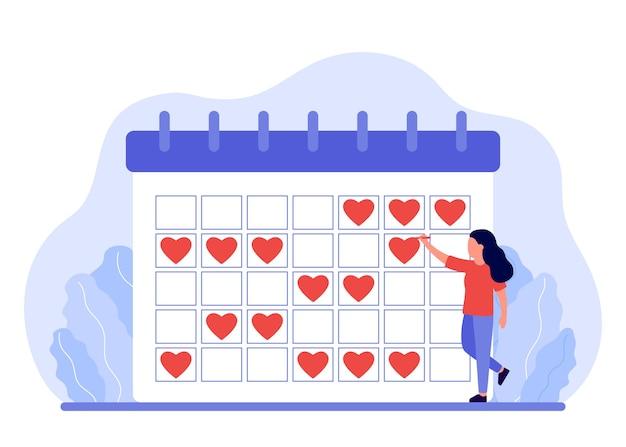 Vrouw plant haar kalender met behulp van de platte illustratie van het rood hart teken