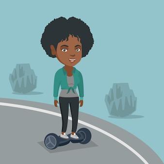 Vrouw rijdt op een zelfbalancerende elektrische scooter.