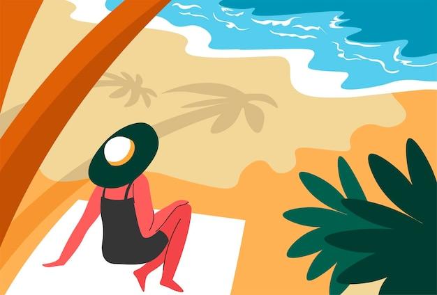 Vrouw rust aan zee in de schaduw van palmbomen