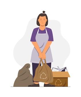 Vrouw sorteert het afval om te recyclen
