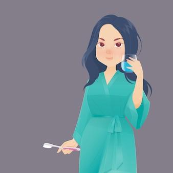 Vrouw spoelen en gorgelen tijdens het gebruik van mondwater