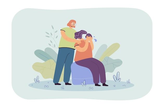 Vrouw troostende huilende vriend en wat betreft haar schouders. meisje dat lijdt aan angst, eenzaamheid, probeert om te gaan met depressie of verlies