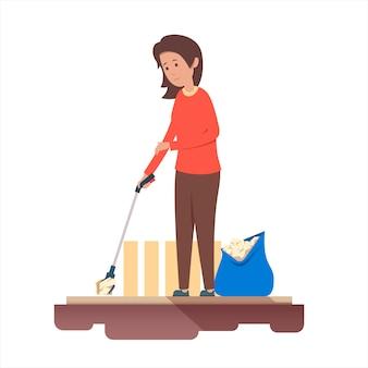 Vrouw verzamelt afval met hulpmiddelen. afval recyclen.