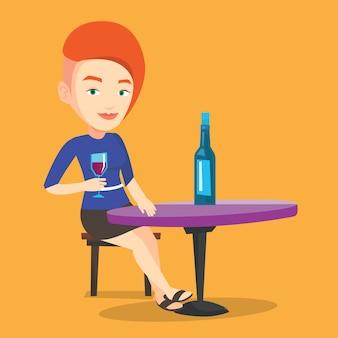Vrouw wijn drinken in het restaurant.