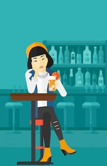 Vrouw zitten aan de bar