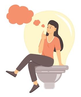Vrouw zitten op grote lamp en goed idee denken.