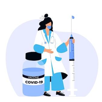 Vrouwelijke arts houdt enorme spuit vast met coronavirusvaccin covid-19. vaccinatie campagne. tijd om te vaccineren.
