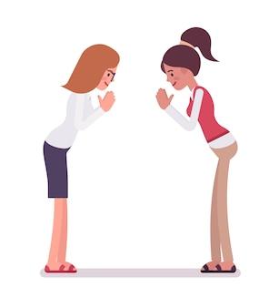 Vrouwelijke bedienden die een boog geven