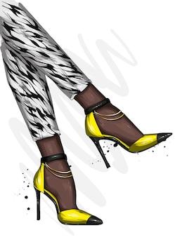 Vrouwelijke benen in stijlvolle schoenen met hoge hakken