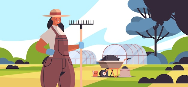 Vrouwelijke boer in uniform bedrijf hark eco landbouw landbouw concept landelijke landbouwgrond platteland landschap horizontaal portret vector illustratie