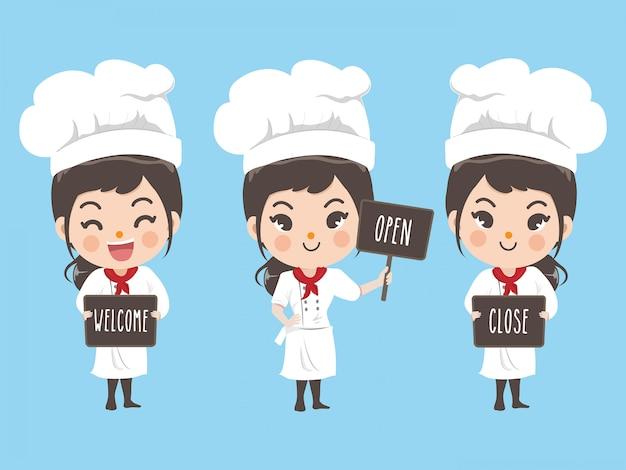 Vrouwelijke chef-kok houdt een teken aan de voorzijde van de winkel.