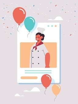Vrouwelijke chef-kok in uniform viert dag van de arbeid