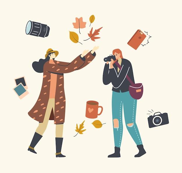 Vrouwelijke fotograaf karakter herfstfoto maken voor meisje gevallen bladeren gooien
