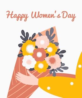Vrouwelijke hand die een boeket van bloem, groetkaart houdt