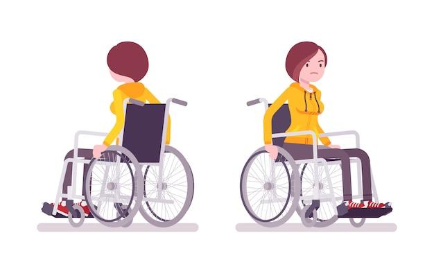 Vrouwelijke jonge rolstoelgebruiker rijden