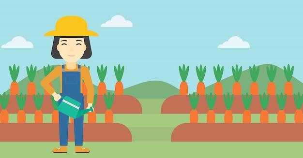 Vrouwelijke landbouwer en gieter