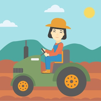 Vrouwelijke landbouwers drijftractor