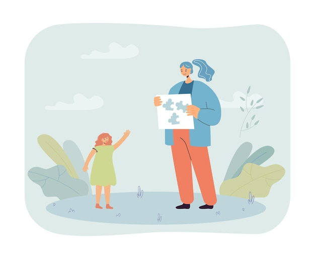 Vrouwelijke leraar die puzzel toont aan klein meisje