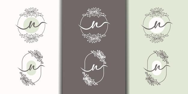 Vrouwelijke letter n met bloemenframe logo sjabloon