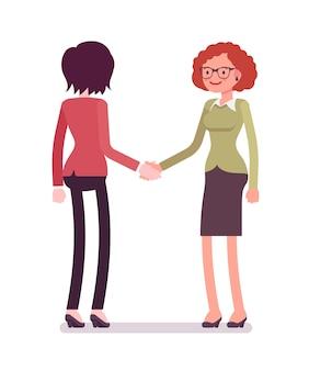 Vrouwelijke ondernemers in handdruk