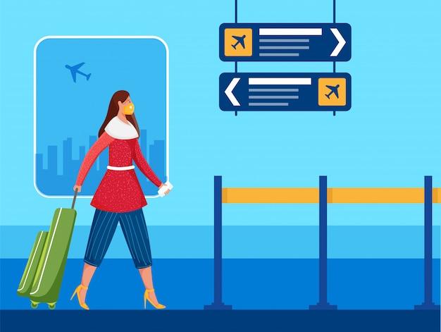 Vrouwelijke passagier draagt beschermend masker lopend op luchthaven om coronaviruspandemie te voorkomen.