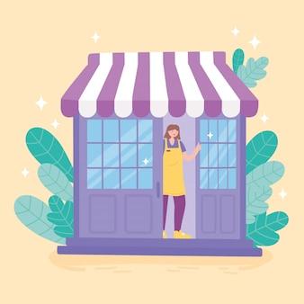 Vrouwelijke werknemer opent de deur van de winkel