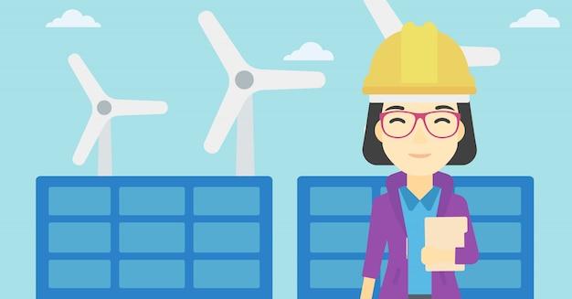 Vrouwelijke werknemer van zonne-energiecentrale en windmolenpark.