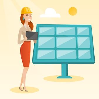 Vrouwelijke werknemer van zonne-energiecentrale.