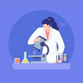 Vrouwelijke wetenschapper die door een microscoop kijkt