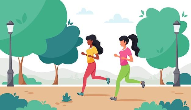 Vrouwen die in het park rennen.