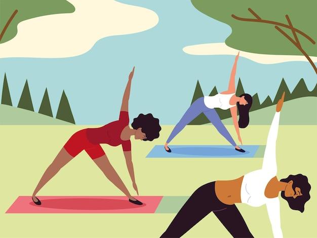 Vrouwen die yoga maken in het park