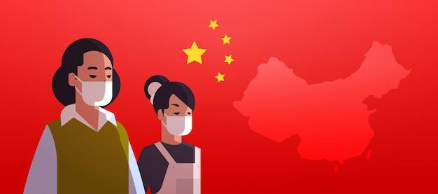 Vrouwen dragen van beschermende maskers om epidemie virus concept wuhan coronavirus pandemie medische gezondheidsrisico chinese vlag portret horizontaal te voorkomen