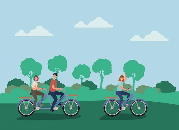 Vrouwen en man tekenfilms fietsen in het park