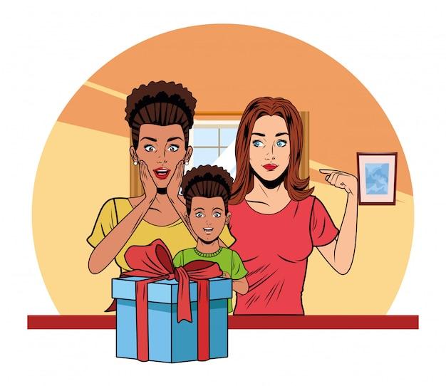 Vrouwen en meisje met geschenkdoos
