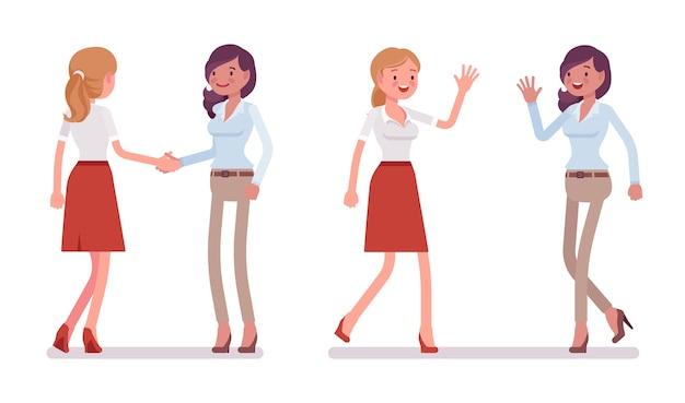 Vrouwen in handdruk en high five-gebaar
