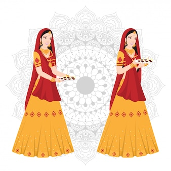 Vrouwen in indiase traditionele kleding op mandala.