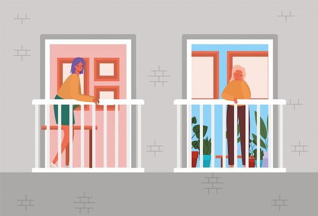Vrouwen kijken uit de ramen met balkons van grijs huisontwerp