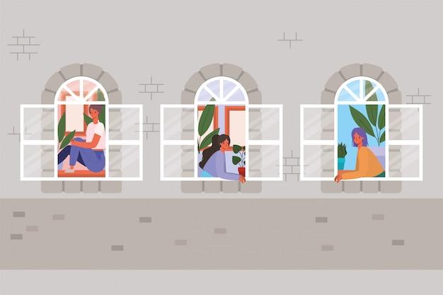 Vrouwen kijken uit de ramen van grijs huisontwerp