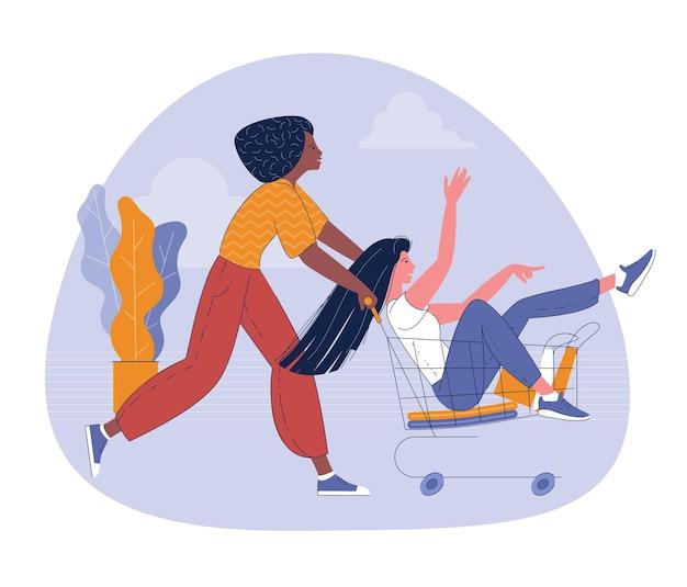 Vrouwen rijden supermarktkar genieten met gelukkig shopping concept