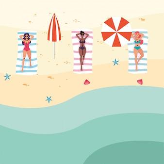 Vrouwen tussen verschillende rassen op het strand die sociale afstand uitoefenen
