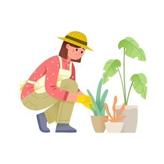 Vrouwen verzorgen planten in potten met handschoenen