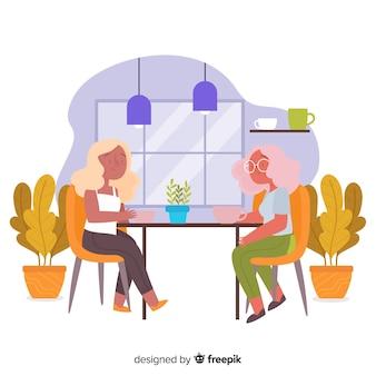 Vrouwen zitten in het café