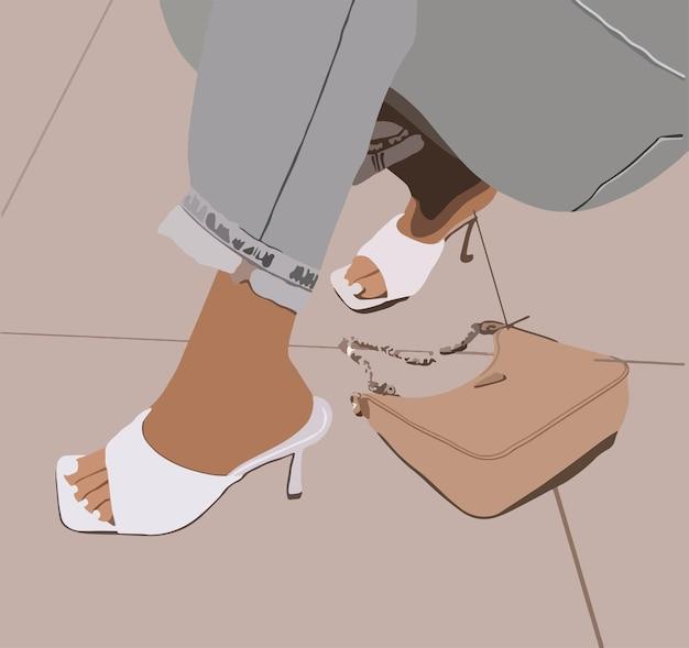 Vrouwenbenen in witte schoenen en jeans.