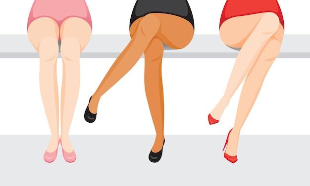 Vrouwenbenen met verschillende huid en soorten schoenen, zittend met gekruiste benen