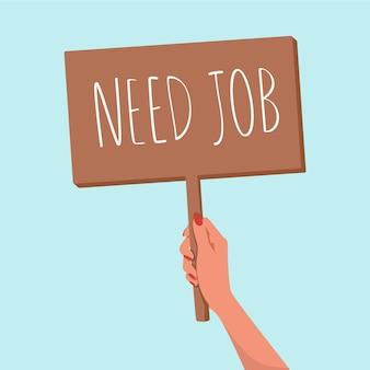 Vrouwenhanden houden een houten bord vast, hebben werk nodig. concept van vrouwelijke werkloosheid in de economische crisis