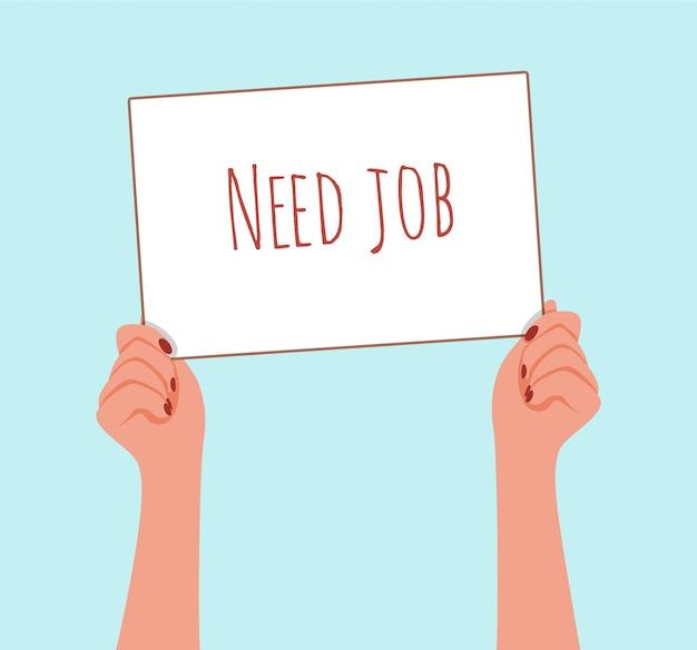 Vrouwenhanden houden een teken vast dat ik werk nodig heb. het concept van vrouwelijke werkloosheid in de economische crisis